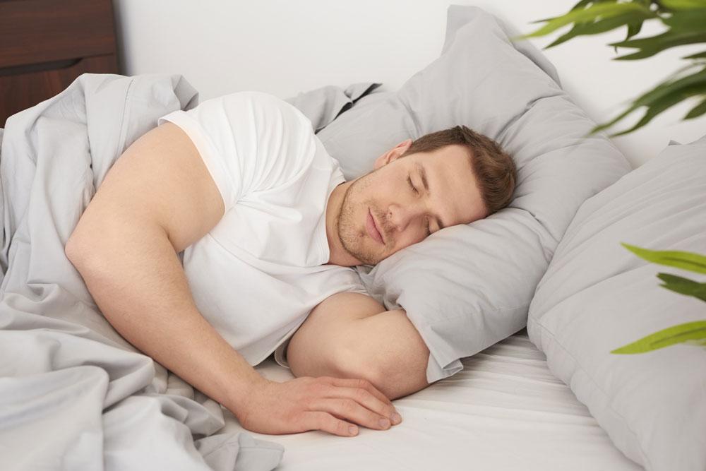 Man Sleeping Comfortable Bed
